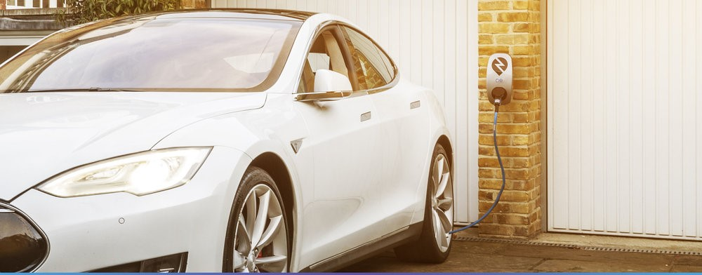 image of a car and an ev charger